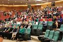 Attendees listen to the keynote address.